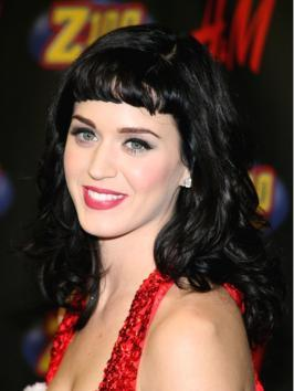 Katy Perry's sultry sculpted waves are perfect for any formal occasion. Her hair has been wrapped around an extra wide barrel curling iron to create oversized curls, then brushed out.