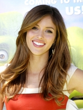 Actress Kayla Ewell knows she can't miss with long, polished curls pulled over the shoulders. To copy her curly hairstyle, blow hair out smooth and work through with shine serum. Then take small sections and vertically-wrap them around a 1-inch curling iron.