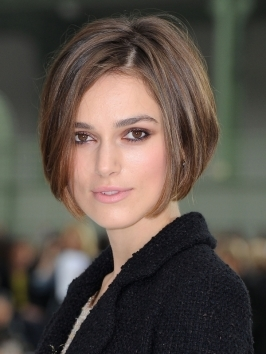 The angled cut of Keira Knightley's bob is softened by styling hair from a side part with a light, touchable finish. By parting hair to the side, layers come in to curve around the face, framing it beautifully.