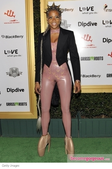 Nicki Minaj channeled her extravagant side into this mesmerizing and high street Givenchy couture ensemble. Her safari style look was further crowned with her funky hairdo and eye-popping pink lips.