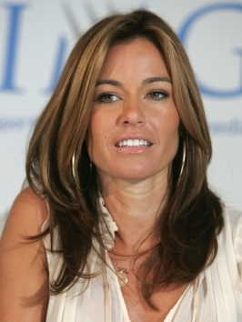 Caramel highlights play up Kelly Bensimon's brown base color, to brighten things up around the face.