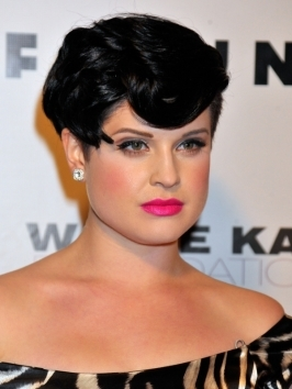 Kelly Osbourne hit up the Kreiss 75th Anniversary party rocking a high bun updo hairstyle. She gathered her shoulder-length purple locks into a high pony, then wrapped length around the base of the pony and secured  the bun for bobby pins.