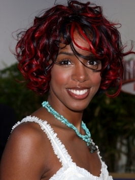 Kelly Rowland opted for pretty, natural curls for the 2012 Grammy Awards celebrations. To style ringlets that are frizz-free, work through with curl-enhancing product while hair is still damp, then air- or diffuse dry.