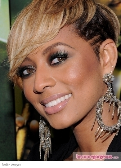 Keri Hilson rocked bright purple lips while visiting New.Music.Live. She paired the bold lip with luminous skin and soft smokey eyes to balance out the look.
