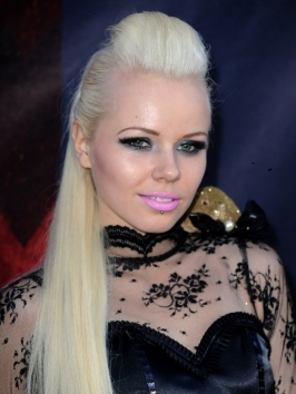"Estonian songstress Kerli hit up LOGO's 2012 ""NewNowNext"" awards donning her signature brightly colored hairdo. This time she added even more color and wore her locks in multiple braids."