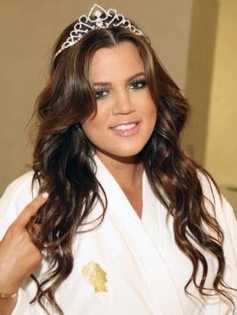 Khloe Kardashian takes a break from her go-to down locks and wears her wavy texture hair into a cute half up/half down hairstyle. To style, use large hot rollers or curling iron for loose waves, pull back front layers and pin back.