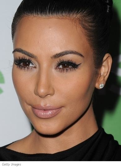 "Kim Kardashian attended QVC's ""The Buzz On The Red Carpet"" cocktail party wearing a statement red lip. The rest of her makeup look was kept simple with lined eyes and bronzed cheeks."