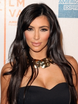 http://static.becomegorgeous.com/gallery/pictures/kimkardashianhairstyles_2009longwavy.jpg