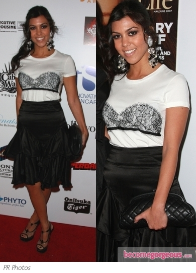 Kourtney Kardashian wears a pretty LBD from Ted Baker's s Langley Court line. The accessorized with Tom Ford pumps and YSL metallic clutch bag.