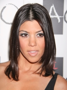 Kourtney Kardashian's updo gets a trendy twist with French braid accents along the sides. Comb in a middle part and French braid each side firmly, then twist ends into a bun and pin into place.