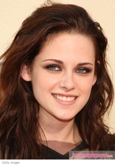 "Kristen Stewart is out and about promoting ""The Twilight Saga: Breaking Dawn Part 1"". Here, her blue eyes are smoked up with tones of grey paired with iridescent pearl on the inner 1/3 of the eyes to soften the effect. Barely-there blusher and clear lip gloss complete the nighttime makeup."