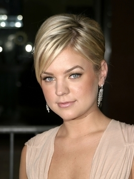 Kirsten Storms sizzles in big blonde curls - volume is concentrated at the sides rather than on top, so the look doesn't seem at all forced.