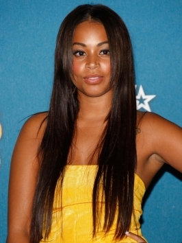 A fan of lengthy locks, Lauren London's combined her extra long hair with a deep center part with layering around the face.