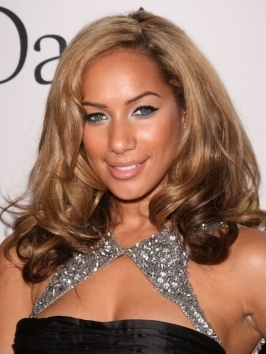 Here, Leona Lewis worked with her natural texture. Mix a curl-enhancer and mousse into damp hair to encourage natural curls and diffuse-dry. Gather locks to the side and pin into a loose, unstructured bun. Pulled out  pieces add more charm to the look.