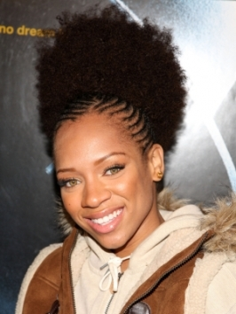 Lil Mama is sporting a cute hairstyle featuring thin cornrow braids and a big fluffy hair piece, creating an attitude-packed updo with lots of texture.