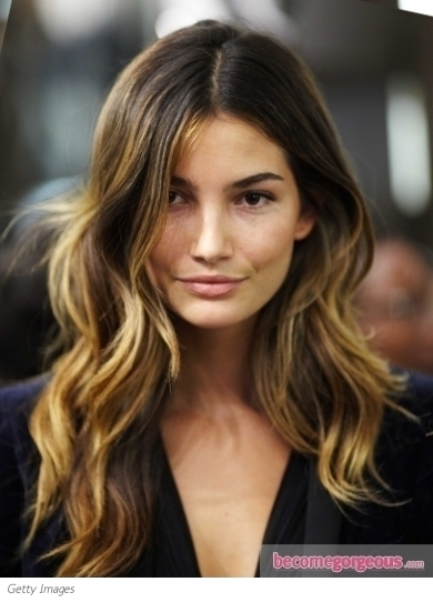 Defined, loose curls swirling down low paired with smoother strands up high continues to a look women love! Lily Aldridge 2011 Victoria's Secret Fashion Show Viewing Party with her locks styled for sassy end curls with a shiny finish.