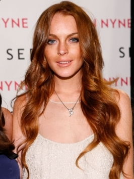 Lindsay Lohan attended the 2011 amfAR Milano dinner with her blonde hair secured in a loose, low ponytail. Her long bangs were flicked  and swept to the side.
