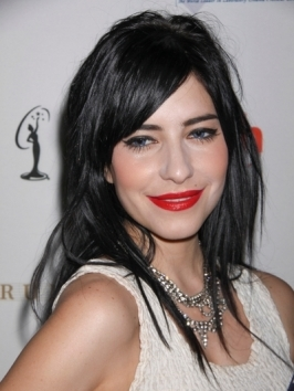 Lisa Origliasso's bangs are super trendy additions to the shoulder-length blunt cut bob. Get the look by having your stylist snip bangs straight across and having the sides cut on a subtle angle. Flat-ironing will give you that supper-sleek surface.