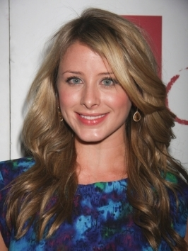 Lo Bosworth goes for a simple half updo hairstyle while hosting the Verizon Wireless Samsung Rogue launch in Las Vegas.
