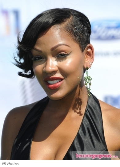Meagan Good wore an updo with her signature side sweeping bangs for the 2011 ...
