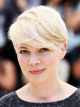 Michelle Williams' asymmetric crop is a cool take on the  layered pixie with a freshened, edgier feel. With one side cut close to the head and the opposite left intentionally longer, Michelle's new hairstyle creates a fun contrast with a textured finish.