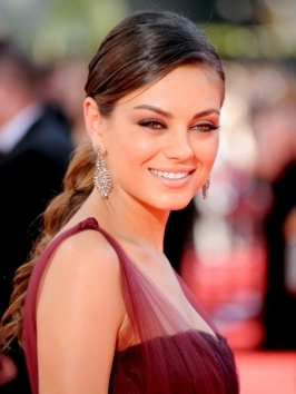 Mila Kunis worked her shiny locks with glossy end waves at the 2012 MTV Movie Awards. To style, blow-dry hair smooth and flick ends with your flat iron for a super-shiny finish.