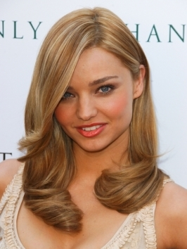 Sleek curves, root lift and an above-the-eye part make Miranda Kerr's blow out hairstyle ultra luxe. Thick hair types work best for this look as they will hold the swingy texture in place.