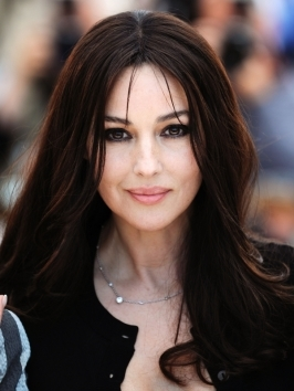 Monica Bellucci's long wavy hairstyle is paired with a beautiful rich brunette color that bring warmth to her complexion.