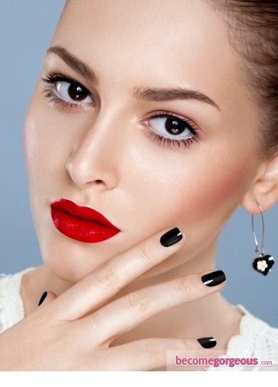 Bring out your peepers with this glamorous cat eye makeup look on New Year's Eve! Use iridescent white on the mobile lid and work a matte taupe eyeshadow into the crease. Line the eyes using a soft khol and black liquid/gel liner creating a slightly exaggerated the flick. Line the lips with a flesh tone lip liner and a drop of your favorite sheer lip gloss.