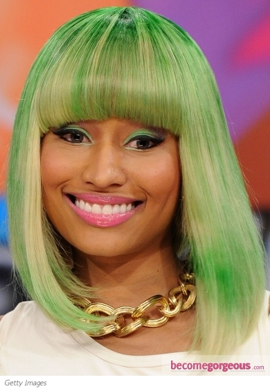 Nicki Minaj is a real fan of edgy beauty trends, therefore pairing her acid green eye makeup with bright pink lips seemed the perfect means for the young diva to stand out from the crowd.