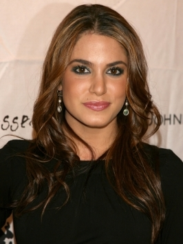 Classy & glamorous! Nikki Reed donned a stylish looped updo to the 'The Twilight Saga: Breaking Dawn - Part 2'.  Her hair was slicked down from a side part and pulled back tightly into a looped low bun.
