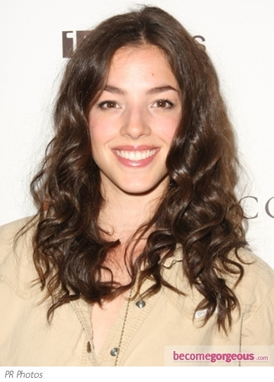 A full-out fringe takes center stage in Olivia Thirlby's short haircut courtesy of longer, texturized layers up top and close-clipped back. For hair this bold and revealing, make sure you have petite, even features and lots of attitude!