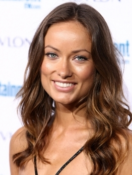 Blue-eyed beauty Olivia Wilde wears her shoulder length brunette locks styled with loose waves and lots of shine.
