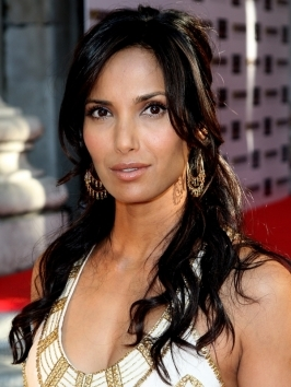 Escaping pieces in the front makes Padma Lakshmi's wavy half updo so romantic. Her hairstyle works well for naturally wavy hair and looks simple and elegant.