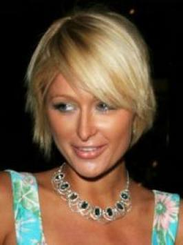 Paris Hilton hit up the 2012 MTV Movie Awards with poker straight locks. Her long blonde layers are teamed with whispy bangs directed to one side.