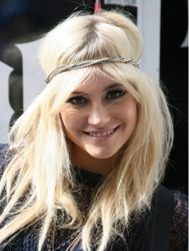 Pixie Lott tressed up her bob with lots of deliberately unkempt curls. If your hair has abundant natural curls, style it with a mix of curl-enhancer and frizz-tamer and blow dry with the diffuser.