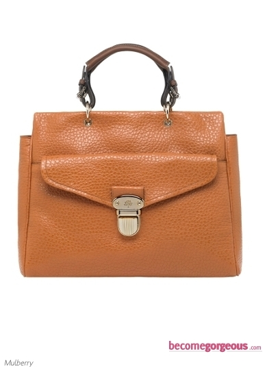 Purchase this dazzling Bayswater Camel Leopard Bag from the oh-so-popular Mulberry tote family and let this high street accessory speak for your sophisticated taste for statement style creations.
