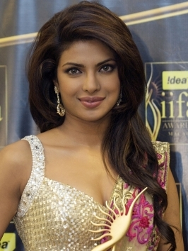 Priyanka Chopra's shoulder-length haircut features plenty of layers to reduce the bulk of the hair. Top volume, tapered sides and flippy ends create a flattering silhouette for her face shape.
