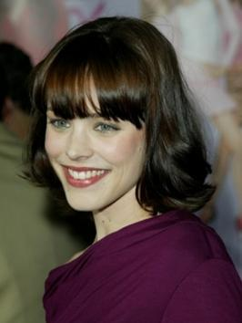 Rachel McAdams added a sexy twist to her blonde layers with a pair of long, lash tickling bangs. Her hair is styled for movement with a sleek, shiny surface and bangs are tugged down to just skin the eyes for a flirty finish.