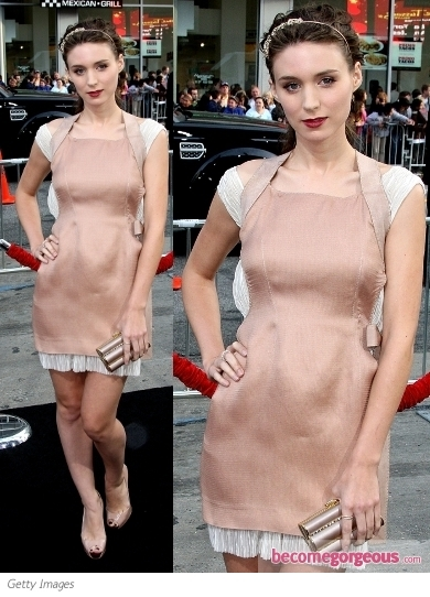 Rooney Mara shows some skin in this revealing design from the J. Mendel Fall 2012 ready-to-wear collection. As usual, Rooney kept accessories to a minimum with a pair of nude Prada Cruise 2012 sandals.