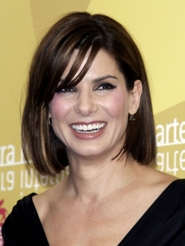 Sandra Bullock's version of the ponytail from the 2012 Oscars has a glamorous twist with its high-drama placement and high shine finish. To put an elegant spin on the old ponytail, wrap a section of hair around the base several times to hide the elastic band.