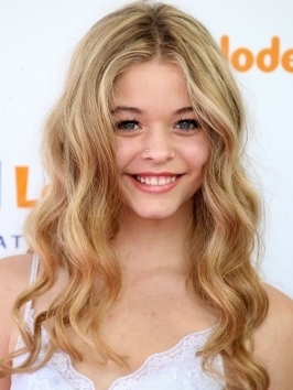 15 year old actress Sasha Pieterse hit the red carpet with her long golden locks styled with shapely end curls. Wind hair around a large barrel curling iron to get similar texture.