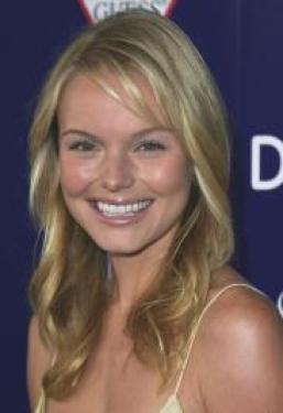 Adding end curls works on medium hairstyles too - check out Kate Bosworth's buttery blonde curls. Her hair was styled from a clean center part, left smooth and close to the crown on top.  Curls have been styled with a curling iron, winding from mid-shaft to end.