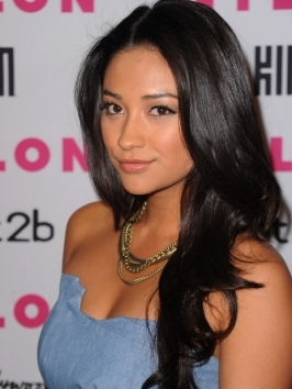 Shay Mitchel hit up the 2012 People's Choice Awards with her extra long locks blown out for a hint of volume and lots of shine. To style, arm up with a good blow dryer, thermal protector and a round brush and finish with gloss drops and hairspray.
