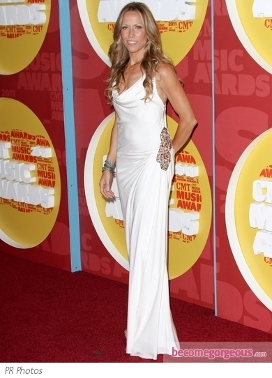Shania Twain wore a Douglas Hannant design for the 2011 CMT Music Awards. Black satin clutch and matching sandals complete her look.
