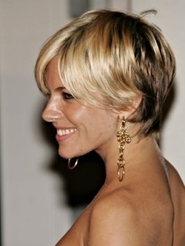 Center parted, casual layers have become Sienna Miller's signature hairstyle. To copy her look, blow out hair for smoothness, turning ends under and create movement around the face. Top the look with shine serum and hair spray.