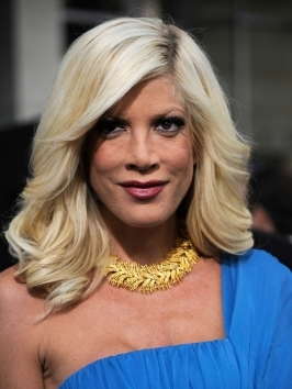 Tori Spelling rocks an asymmetrical blonde with a vibrant blonde color.  The sharply angled sides follow the lines of the jawline.