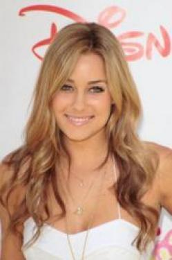 Usually wearing her long blonette locks loose, Lauren Conrad likes to make a statement with retro inspired updos. Lauren wore a loosely twisted side bun paired with a side-sweeping bang for a red carpet event - pure easy-wear elegance.