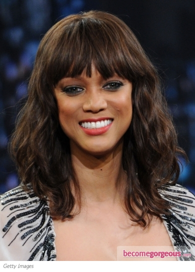 Banks Haircut : Tyra Banks Wavy Hairstyle with Bangs Makeup Tips and Fashion