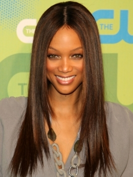 Tyra Banks gets her glam on with sassy, shapely curls. Shiny curls with a strong center part are perfect when you're out for stroll and don't know who maybe around the corner.